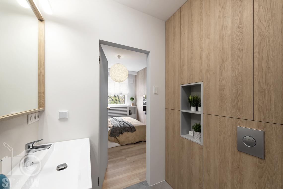 Sesje fotograficzne wnętrz dla projektantów i architektów wnętrz, łazienka, umywalka, lustro, szafki, drzwi do sypialni, lampa wisząca.